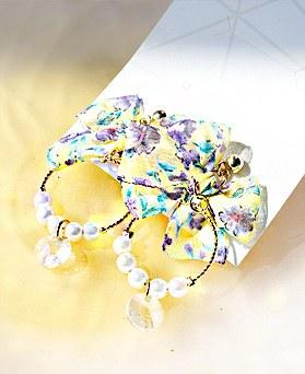 1049592 - <ER2231_GK06>真珠Annフローラルリボンピアス